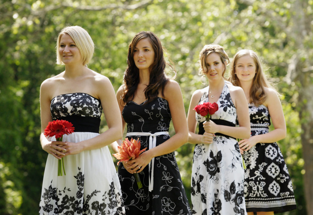 Bridesmaids wait for outdoor wedding ceremony in Annandale, Virginia
