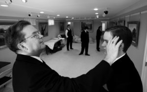 Father and groom getting ready before his wedding ceremony in Annandale, Virginia