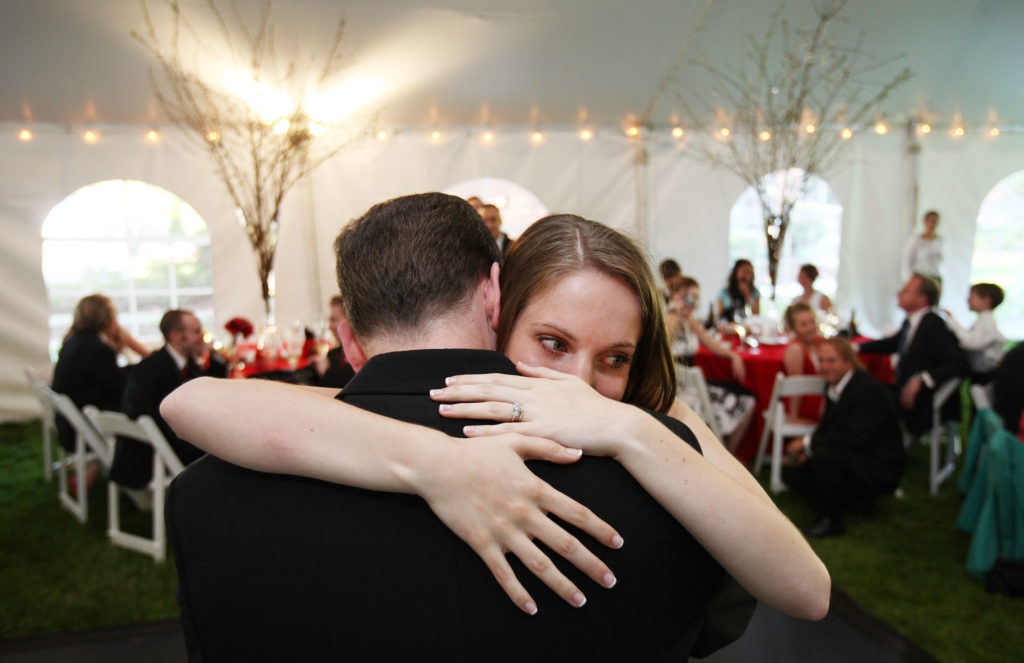 Bride hugs her father during her wedding reception in Annandale, Virginia