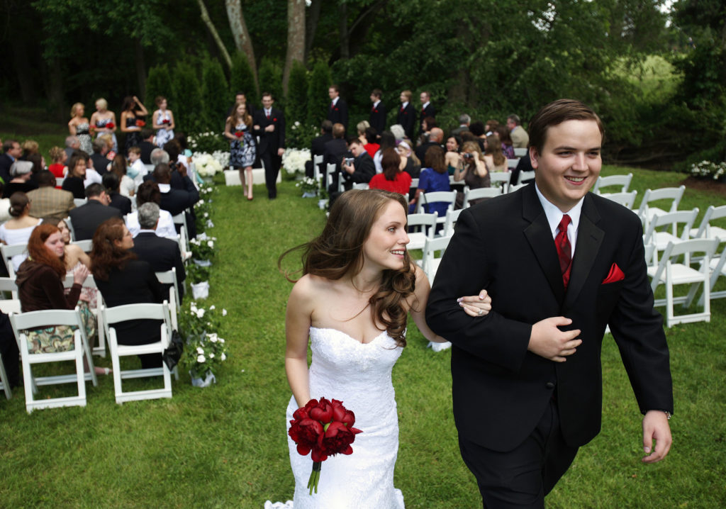 Husband and wife leave their backyard wedding ceremony in Annandale, Virginia.