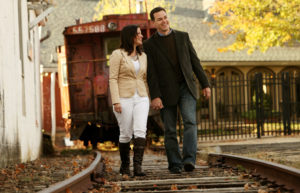 Outdoor engagement portrait on railroad tracks in Warrenton, Virginia.