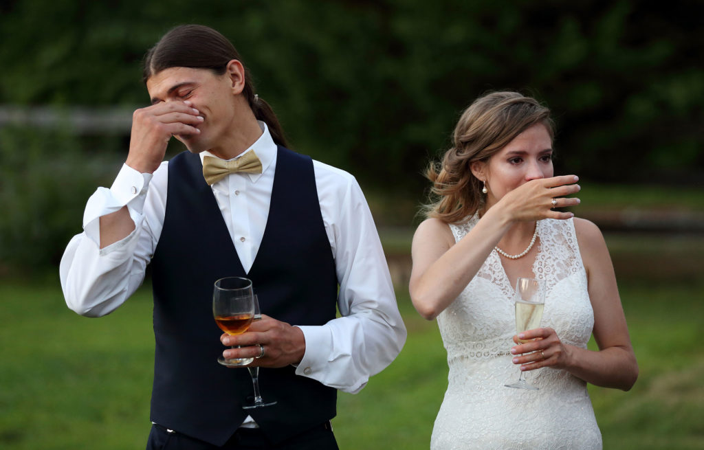 Bride and groom cry during the wedding toast during their outdoor wedding in Warrenton, Virginia.