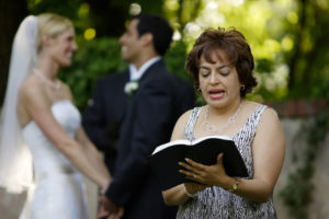 Wedding reading during the outdoor ceremony held at Alwyngton Manor in Warrenton, Virginia