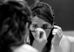 Bride getting ready before her wedding ceremony held at the Fort Belvoir Officers Club in Fort Belvoir, Virginia
