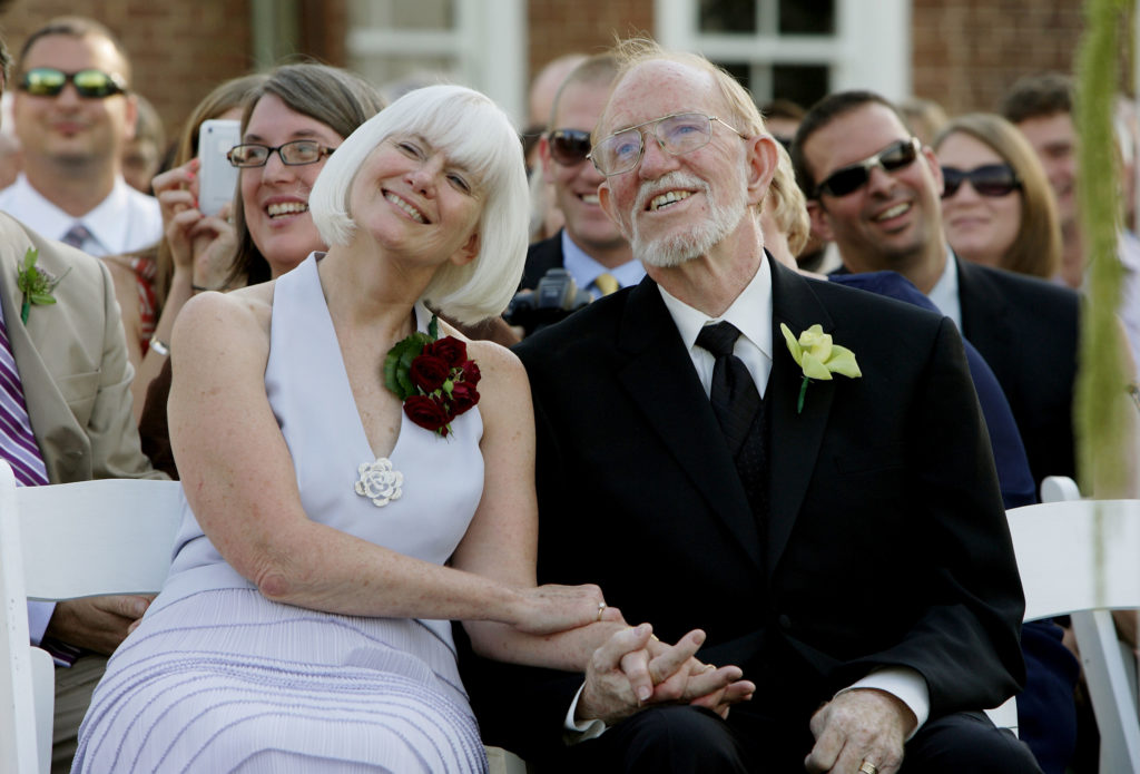The parents of the bride watch their daughter's outdoor wedding ceremony at Raspberry Plain in Leesburg, Virginia.