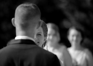 Bride and groom exchange vows during their wedding ceremony under a gazebo at Fauquier Springs Country Club in Warrenton, Virginia.