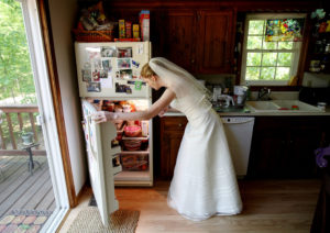 Bride looks in refrigerator