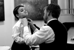 Getting ready before his dad's wedding at the Torpedo Factory Art Center in Alexandria, Virginia.
