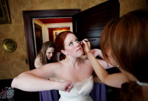 Bride getting ready before her wedding ceremony at Raspberry Plain in Leesburg, Virginia.