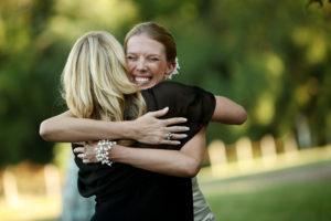 Bride hugs her mother