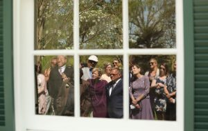 wedding guests reflected in window